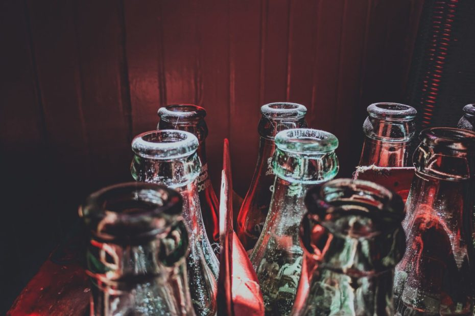 selective color photography of glass bottles